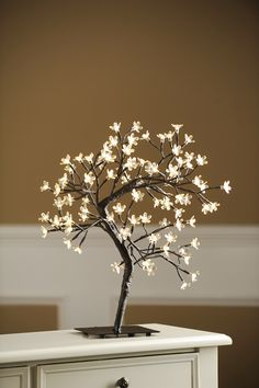 Bring the beauty of nature indoors with the Pre-Lit White Cherry Blossom Tree. Plug in this charming tree to see the beautiful blooms sparkle and shine with warm white light! Buy this piece on sale for $20 today only.
