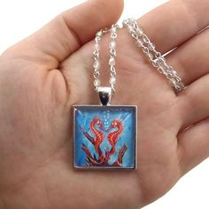 RE-PIN: Ever dream of an aquarium that didnt need to be cleaned? Enter: Seahorse Kiss. Click the link in my bio to shop #FantasyArtPendants #ByKKSwann feat. @DrakeyArt!  ### #feedyourwhimsy #drakeyart #fantasyart #fantasyartnecklace #necklace #handmadenecklace #designernecklace #aquarium #seahorse #seahorsekiss #seahorses #underthesea #seahorsenecklace #seahorsependant bykkswann.com