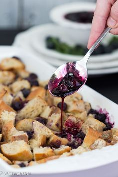 Blueberry Bread Pudding - Sweet dessert made with blueberries and crusty bread served with homemade blueberry sauce. Perfect way to enjoy berries in the summer. Soft, creamy and delicious.