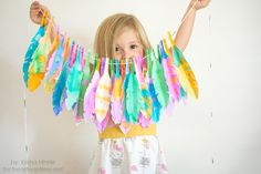 DIY Thanksgiving crafts for kids: a colorful Feather Garland. You could even use more fall, turkey-like colors but our kids have strong opinions! | tutorial: I Heart Naptime