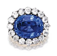circa 1890. Centered by an oval sapphire weighing 25.09 carats, framed by old mine-cut diamonds weighing approximately 4.00 carats, together with a removable brooch fitting and retractable pendant-loop