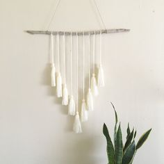 Details: Reclaimed driftwood wall hanging with cream yarn tassels and hemp twine to hang. Measurements: Wood piece is approx. 23 inches across and
