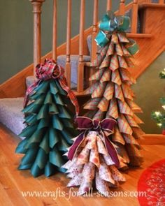 Crafts For All Seasons shows how you can make these beautiful trees out of Christmas wrapping paper. by wanita.desrochers