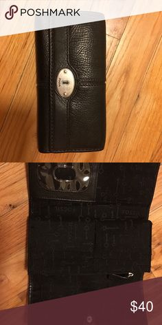 New fossil wallet Fossil wallet in like new condition. It has over 15 card slots and also two pockets with zip. Good quality leather! Fossil Bags Wallets