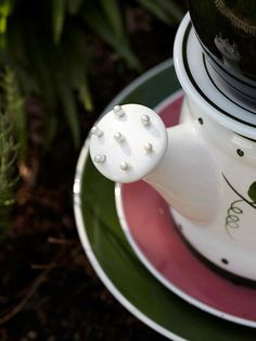 To keep water from entering this teapot, Netta and Judy glued white dressmaker pins into the spout. The pins also add a fanciful detail to the piece's overall design. For larger openings, let your creativity be your guide: Use marbles, ball bearings, or even round shank buttons with the back loop glued and inserted inside the opening, leaving only the ornamental side of the button showing./