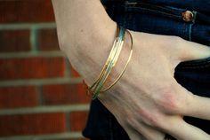 Thin gold bracelet layering bangles by TiffanyAnneStudios on Etsy