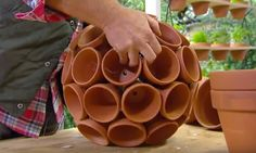 This is a really clever planter for planting multiple plants together. Once the plants are in all of these pots, they look magnificent!