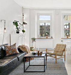 Home with a black fireplace - via cocolapinedesign.com