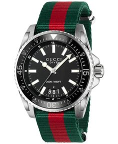 A bold black face, mixed with trendy colors, makes this watch by Gucci quite the eye-catching piece. From the Dive collection. | Red and green striped web nylon strap | Round stainless steel case, 45m
