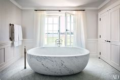 At Villa Maria, a historic manor in Water Mill, New York, the master bath's custom-made marble tub features Waterworks fittings; the space was decorated by CarolEgan Interiors. Photo: Scott Frances