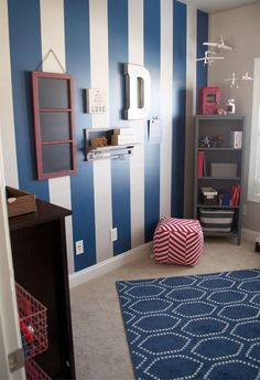 boys room. blue and grey with pops of red. Love the non-theme versatile decor