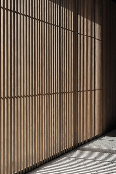 Steinbach Keller is a minimal winery located in Erlangen, Germany, designed by Ulrike Tinnacher Wood Slat Wall, Wood Slats, Japanese Interior Design, Home Interior Design, Japanese Bar, Glass Brick, Wall Paint Colors, Architecture Details, Futuristic Architecture