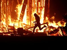 Photos show the fatal moment a man ran into the inferno at Burning Man Jim Bourg/Reuters  A man has died after running into an inferno at Burning Man.  Aaron Joel Mitchell ran through two layers of security officers and into an effigy at the annual gathering in Nevadas Black Rock Desert on Saturday night Pershing County Sheriff Jerry Allen said as cited by the Associated Press.  The 41-year-old was pulled from the flames by firefighters treated on the scene and transported to Burning Mans…