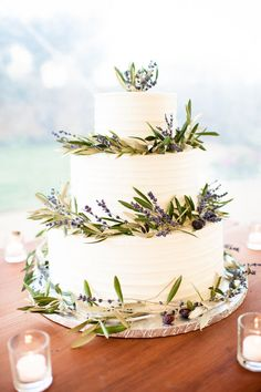 Wine country wedding cake with olive branches and lavender Sweetie Pies Bakery Napa Cornerstone Sonoma Photo By Robyn Navarro Photography @Robyn Navarro