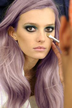 lilac hair, blue eye make up...I wouldn't do it to my hair but it's cute on this girl!