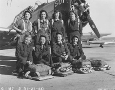 Eight WASP (Women Airforce Service Pilots) at Waco Army Air Field, Waco, Texas, gather on the ramp for a final group picture before disbandment, December 1944. Back row from left: Anne Noggle, Evelyn Taylor, Doris Boothe and Kay Elliott. Front row from left: Clarice Siddall, Lorraine Zillner, Virginia Potthoff and Mary Regalbuto ~