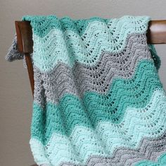 This pretty, lacy afghan makes a special first baby blanket. Click for the free pattern.