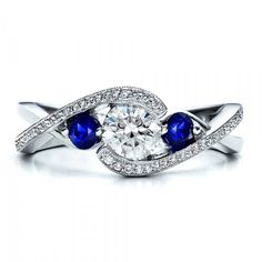 Twisted Engagement Ring with Sapphires. I love this design as well as the gems since I adore rings that overlap, and this looks a bit like that.