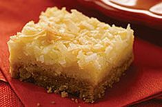 Every sweet, chewy bite of these Lemon Coconut Squares is better than the last. Prepped in just 10 minutes, these dessert squares are easy and delicious. Coconut Squares Recipe, Lemon Coconut Bars, Great Desserts, Dessert Recipes, Calumet Baking Powder, Biscuits, Lemon Squares, Granny Squares, Lemon Recipes