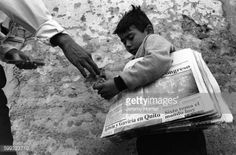 A young boy sells newspapers on a street in Loja, Ecuador. #loja... #loja: A young boy sells newspapers on a street in Loja,… #loja
