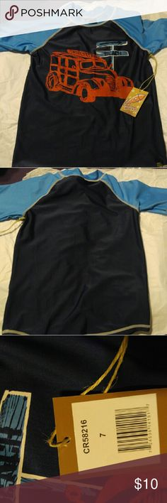 Boys rash guard shirt. New With Tag New With Tags Boys navy and light blue top.  Rash Guard Shirt 3/4 length sleeves Truck picture on front Swim Rashguards