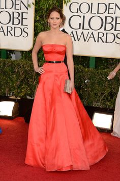 Jennifer Lawrence in Dior Haute Couture. Hate the color, love the shape, and love Jennifer Lawrence even more.