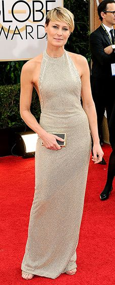 Robin Wright: 2014 Golden Globes The newly-engaged House of Cards actress looked beautiful in a gold-beaded, halter gown from Reem Acra's fall 2013 collection.