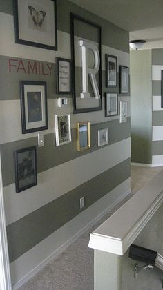 Striped Entryway Walls. I'm liking the pictures and frames too.