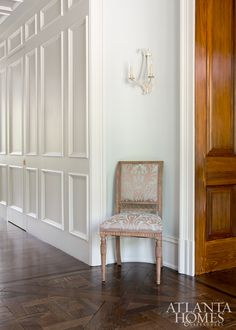 A Louis J. Solomon chair covered in an Old World Weavers fabric sits in hallway niche.