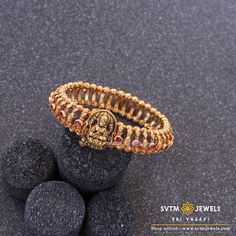 Traditional lakshmi yellow gold bracelet studded with kemp stones,A touch of contemporary style is what this classy bracelet lends to you. Gold Bangles Design, Gold Earrings Designs, Gold Jewellery Design, Necklace Designs, Gold Rings Jewelry, Gold Bracelets, Gold Necklace, Jewelry Model, Indian Jewelry