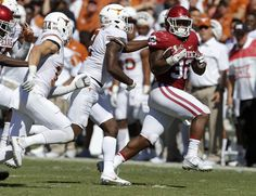 Oklahoma's Samaje Perine (32) runs past Texas' Kris Boyd (2) and Dylan Haines (14) during the Red River Showdown college football game between the University of Oklahoma Sooners (OU) and the Texas Longhorns (UT) at Cotton Bowl Stadium in Dallas, Saturday, Oct. 8, 2016. Photo by Bryan Terry, The Oklahoman