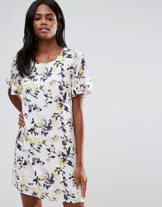 Buy it now. Vila Floral Smock Dress - Multi. Dress by Vila, Printed woven fabric, Scoop neck, Frill sleeves, Relaxed fit, Machine wash, 100% Viscose, Our model wears a UK S/EU S/US XS and is 176cm/5'9.5 tall. Seeking inspiration from street and city style, Danish label Vila combine quality fabrics, textures and delicate cuts to create fashion-forward garments. Intricate feminine detailing and fine prints channel the brand's signature elegant style; with party dresses and cool casuals…