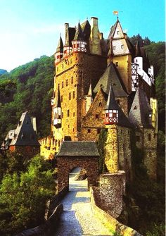 Burg Eltz is a medieval castle in the hills above the Moselle River between Koblenz and Trier, Germany. Still owned by the family that lived there in the 12th century, 33 generations ago.