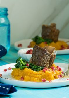 Rosh Hashanah Short Ribs, these beer-braised short ribs are the perfect holiday dish.  The beer gives them the extra flavor and they look so pretty on the plate with butternut squash and pomegranate seeds. Enter to win a box of these Grow and Behold pastured short ribs for the holiday!