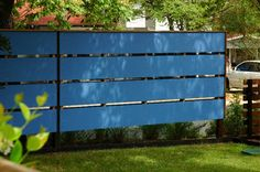 horizontal wooden fences   How cool is this fence? Horizontal boards are the trend with fences ...