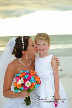 Great colors for Beach Weddings, turquoise, orange, hot pinks and white