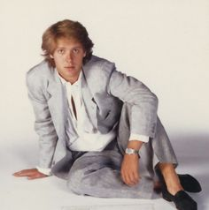 "James Spader (* Men would sometimes not wear socks with their shoes. The ""Miami Vice"" look was in. Pastel Colors,(including Pink), T-shirts underneath a Blazer and no socks with their shoes_LL).,"