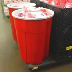 Trash can painted like a giant red solo cup to hold ice & drinks! Fun!