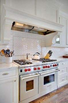 all white: hood, subway tile, cabinets