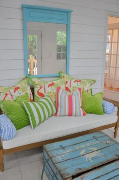 Colorful Pillows and Vintage Style Crates with White Stenciling (Could the crate be made from recycled pallets?) - By Jane Coslick Cottages: Paws And Paddles Cottage