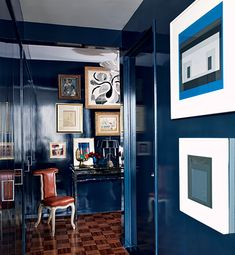 Works by Andy Warhol, Alberto Giacometti, David Hockney, Josef Albers, and others pop against the dark walls of the entrance hall in Todd Alexander Romano's New York pied- -terre. Architectural Digest, Dark Walls, Blue Walls, Design Entrée, House Design, Blog Design, Home Interior Design, Interior Decorating, Interior Ideas