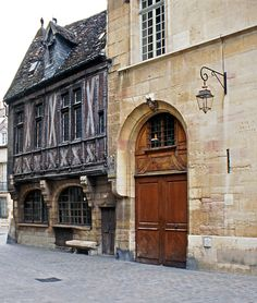 Dijon, Burgundy, France...Is this where the owl is on the side of the building that people rub for good luck? I'm pretty sure that's the bench Cyerno sat in the movie...