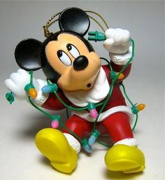 Santa Mickey Mouse tangled in Christmas lights ornament (Grolier) from our Christmas collection Mickey Mouse Christmas Ornament, Disney Ornaments, Hallmark Ornaments, Christmas Crafts For Kids, Christmas Images, Christmas Lights, Christmas Time, Christmas Ideas, Disneyland Christmas