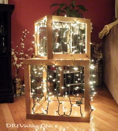 outdoor lighted christmas presents, crafts, seasonal holiday d cor, Create a framed box out of boards Staple on some lights looping them bac. Christmas Boxes Decoration, Outdoor Christmas Decorations, Christmas Lights, Christmas Holidays, Christmas Crafts, Holiday Decor, Light Up Christmas Presents, Lawn Decorations, Xmas Presents