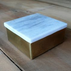 We love the contrast of marble with antique brass on this little box. This little square brass box is useful for a multitude of things as well as looking pretty.
