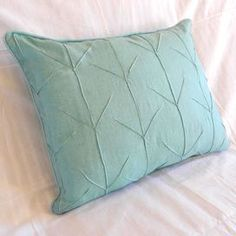 """Linen and cotton-blend throw pillow with arrow motif.Product: Pillow Construction Material: Linen and cotton Color: Ocean        Features: Insert included   Dimensions: 16"""" x 20""""      Cleaning and Care: Machine washable"""