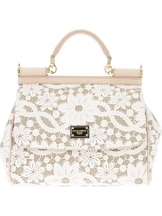 DOLCE and GABBANA Lace Print Tote. This purse is so cute and so far out of my budget. A girl can dream :-)