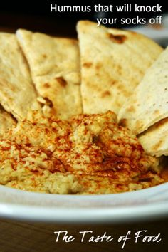 Hummus - 2 (15-ounce) cans chickpeas (I use home fermented) drained and rinsed, ½ cup extra-virgin olive oil, or more as needed, plus more for garnish, ½ lemon juiced, ½ lime, juiced, 2 tablespoons roughly chopped fresh cilantro, 2 cloves garlic peeled, 5 to10 each chili tepin or pequin pods, 1 ½ teaspoon kosher or coarse sea salt, ½ teaspoon dark Asian sesame oil, ½ to 1 teaspoon ground cumin. black pepper to taste, ¼ cup water Ground chipotle chili pepper, for garnish