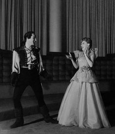 """Judy Garland and Gene Kelly. (1943) Judy garland working on """"Presenting Lily Mars"""" and Gene Kelly working on """"Du Berry was Lady"""" take a break to dance together."""