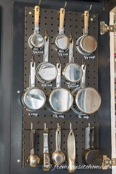 I love this DIY cabinet measuring cup organizer. So easy to do, and my measuring cups and spoons are totally organized now. A great kitchen storage idea! Cabinet Door Storage, Tool Storage Cabinets, Kitchen Cabinet Doors, Diy Cabinets, Kitchen Drawers, Cabinet Ideas, Kitchen Cabinets, Kitchen Organization, Kitchen Storage